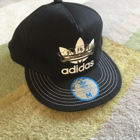 1ea403c850c New Adidas cap hat . Black and white with gold logo on Size - Depop