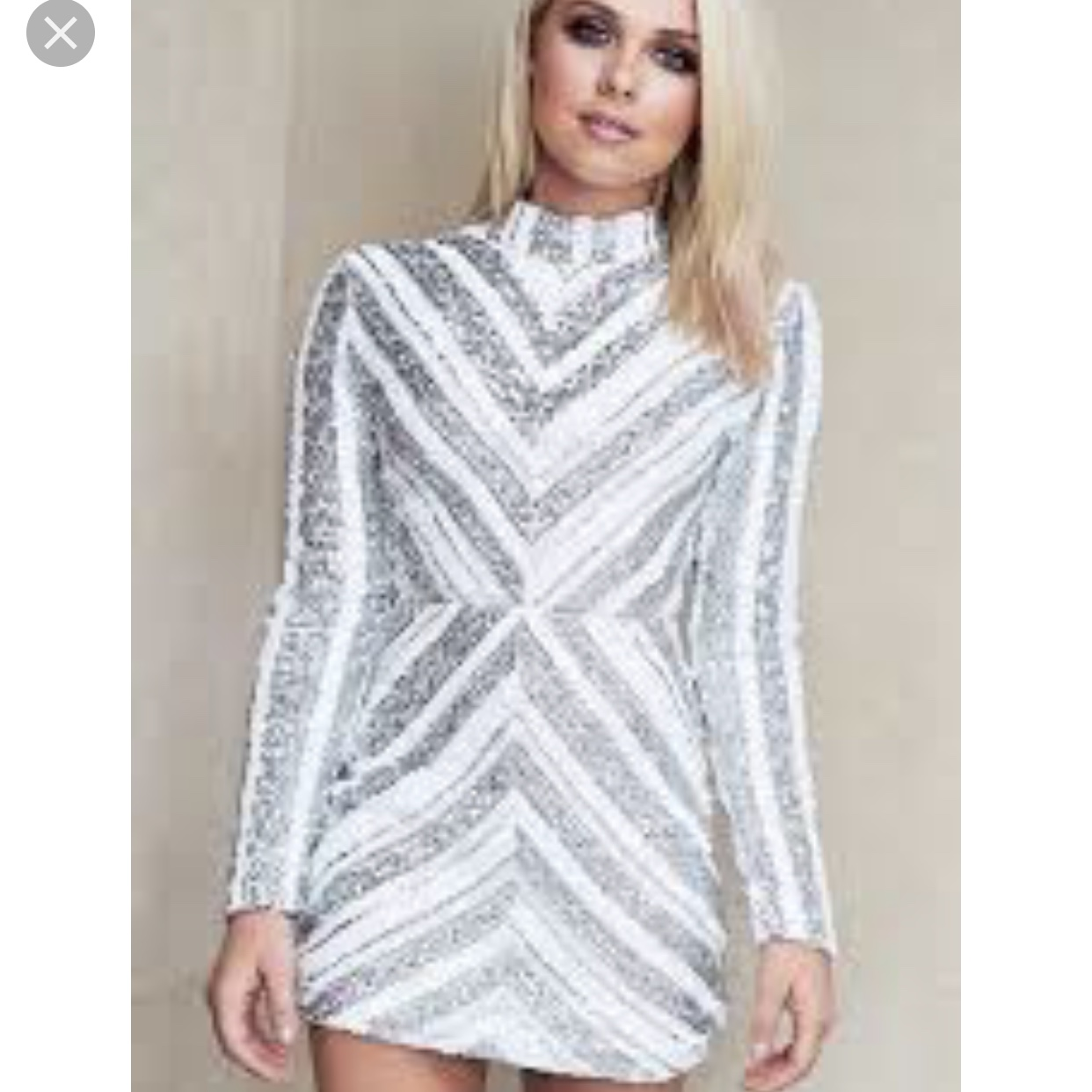 white and silver sequin dress from Quiz