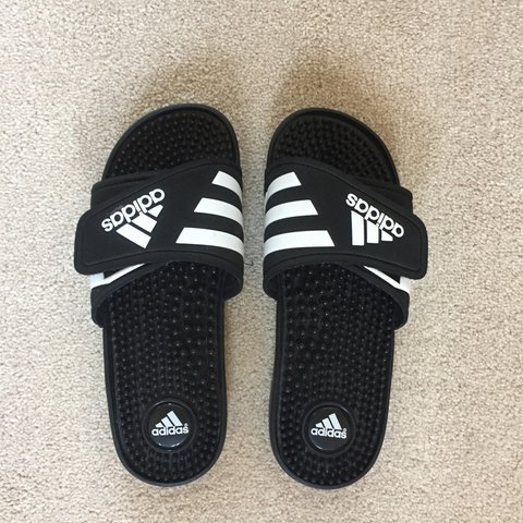 5aed8b708 Black Adidas three stripe slides with massage bumps   Size - Depop