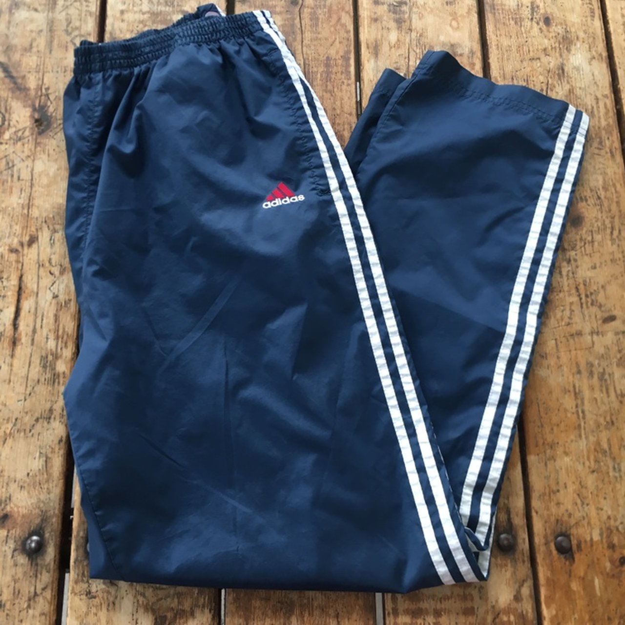 b5bfb8478c30 Vintage Adidas Navy Blue Snap Track Pants  L Condition  Has - Depop