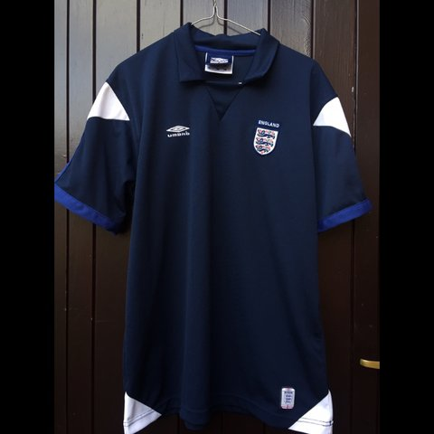 3881452ca Retro style navy Umbro England football shirt