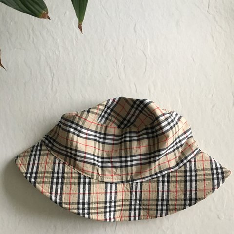 ba0a422a671ea PLAID BUCKET HAT. Similar in looks to the classic Burberry - Depop
