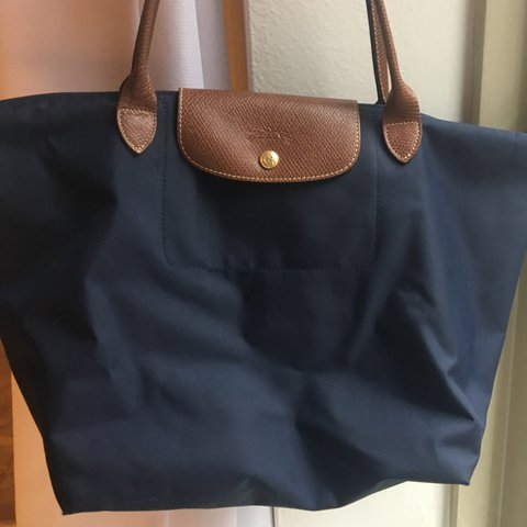 0e0d9d4c55c6 @avadrby. 2 years ago. New York, United States. Large Longchamp Le pliage  Tote Bag in Navy.