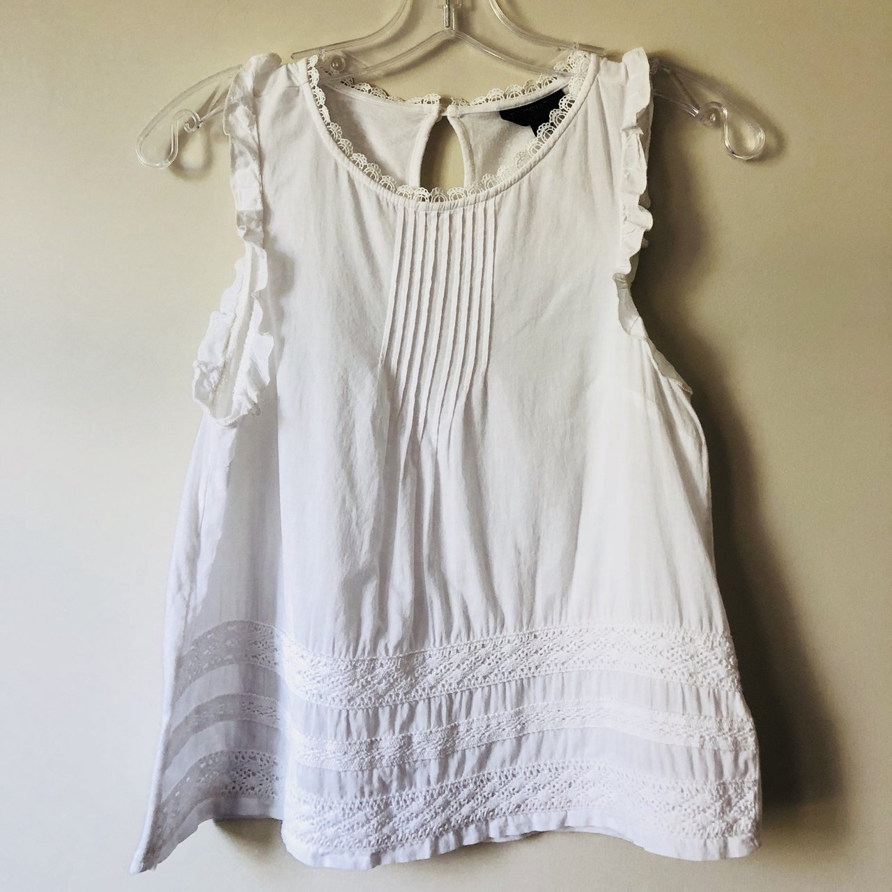 d2c9205289c469 @sallymiasul. 12 days ago. Sterling, United States. NEW White Topshop ruffled  sleeveless top.