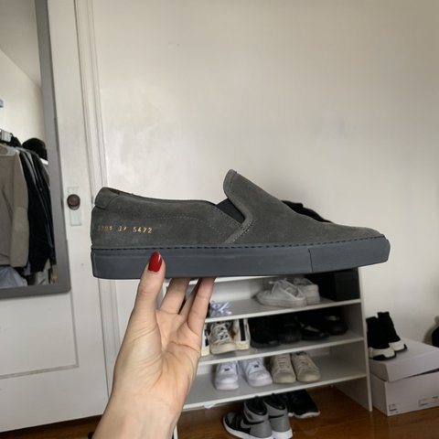 c2e4362c0d2d @jjjings. 11 days ago. Philadelphia, United States. Woman Common Project  dark grey Suede Slip-on style sneakers.