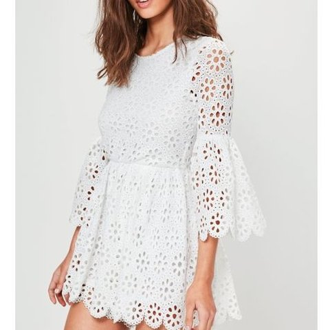 7cf61958f3fe0 Missguided crochet lace flare sleeve playsuit but looks like - Depop
