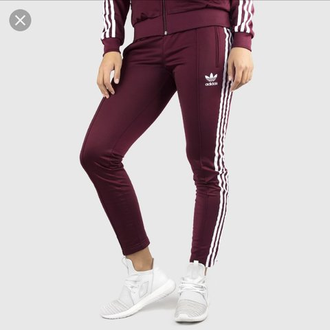 a11e7b595 @kel0892. last year. Orpington, United Kingdom. Maroon red women's Adidas  tracksuit ...