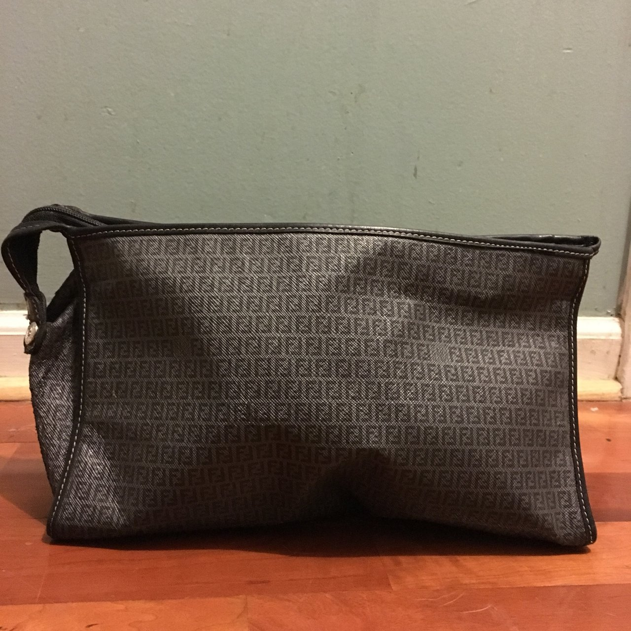 Fendi Clutch bag obvious signs of wear and some areas are in - Depop ee1422cc8ec1e
