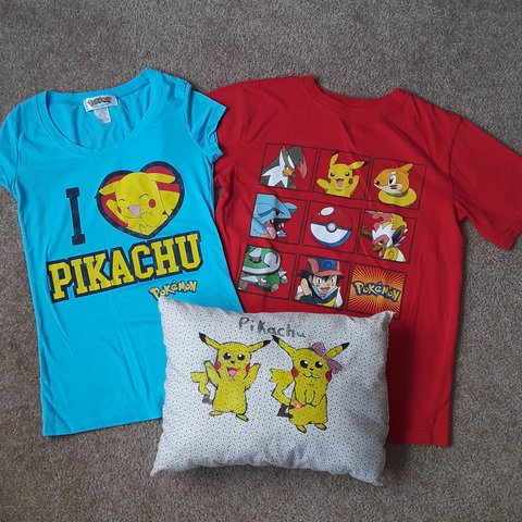 1027ebeb @katskrachiz. last month. Sacramento, Sacramento County, United States. Pokemon  merch. Both shirts are a small. Red is new