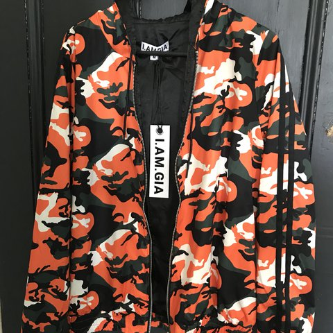 8830ef7dfcbe1 @mxllzzz. last year. West Melbourne, Australia. I AM GIA DAYTONA JACKET  Orange camo print with a satin inner. Size M but ...