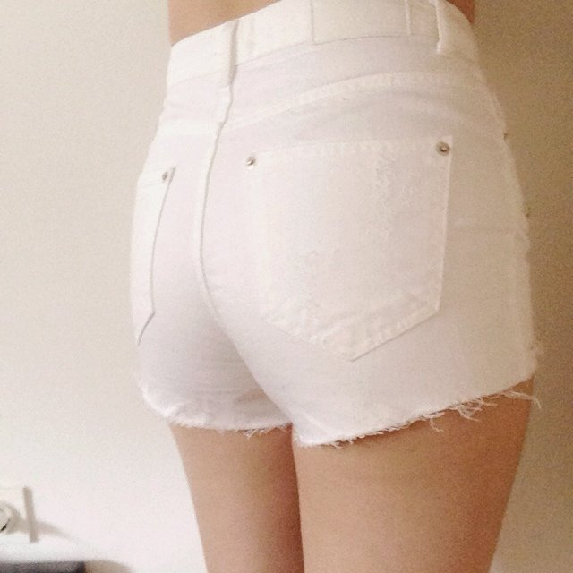 White, ripped, high waisted shorts with silver studs. Worn twice ...