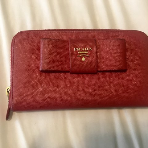 003fe5ce88a9 @tracilee29. 7 months ago. Los Angeles, United States. Authentic red  leather used Prada wallet. Great condition ...