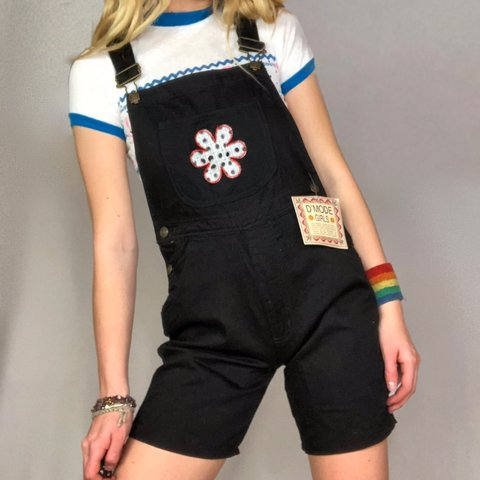 46dd3dccb5c1 90 s does 70 s Vintage black overalls with the cutest flower - Depop