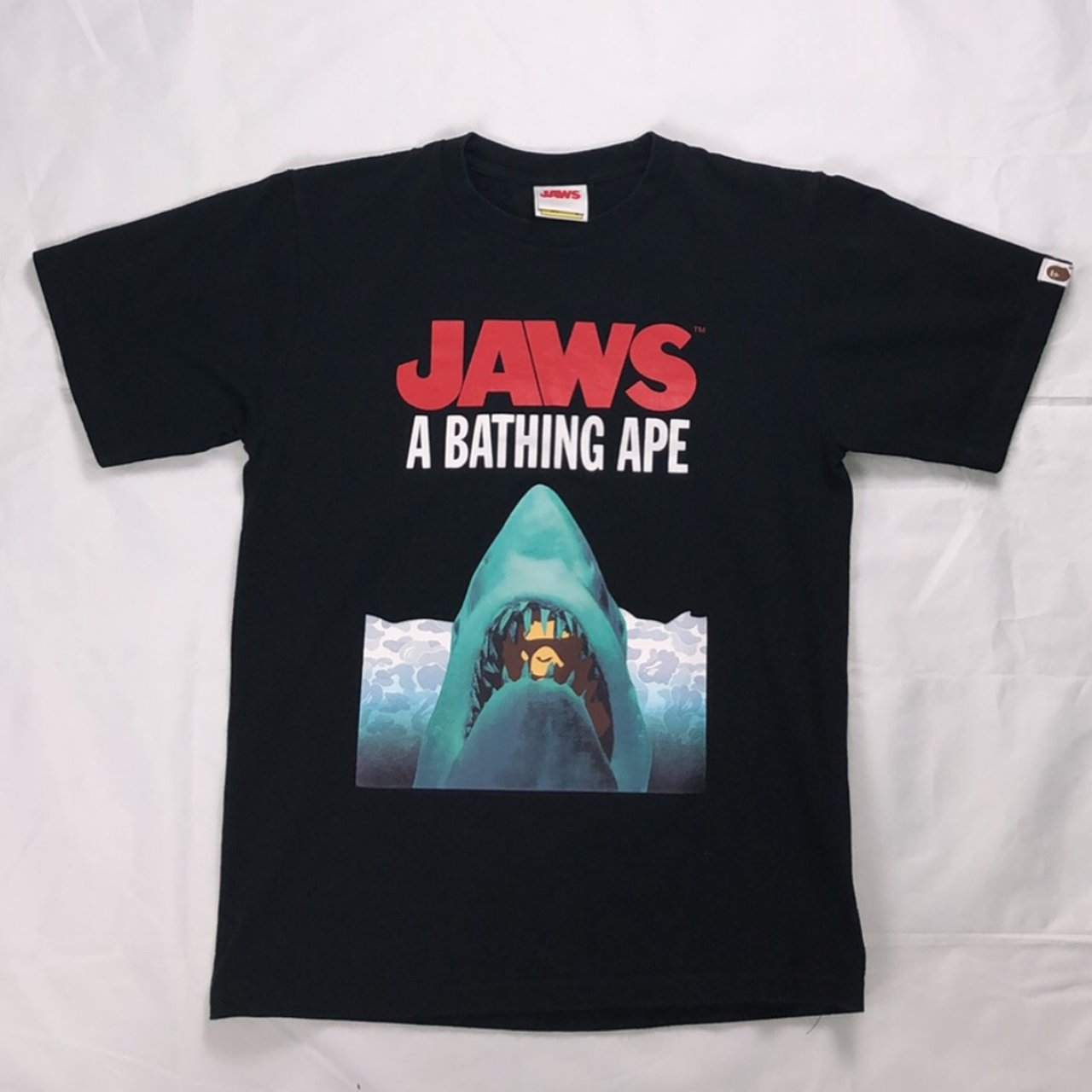 fea13371 Bape x jaws collab tee In very good condition Size small - Depop