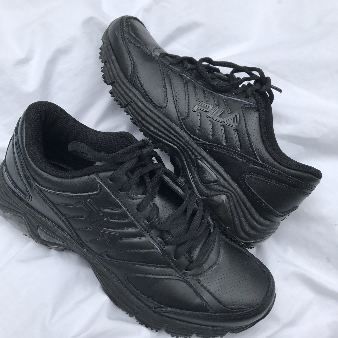 7304d2a3f2 All black fire ass FILA sneakers. In absolutely perfect A  s - Depop