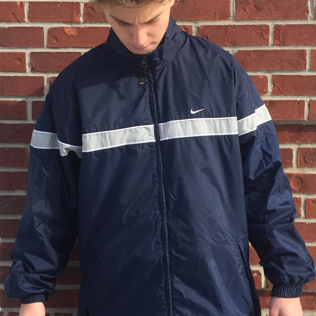 08a8cbc9e39e Nike windbreaker navy blue with grey stripe across chest and - Depop