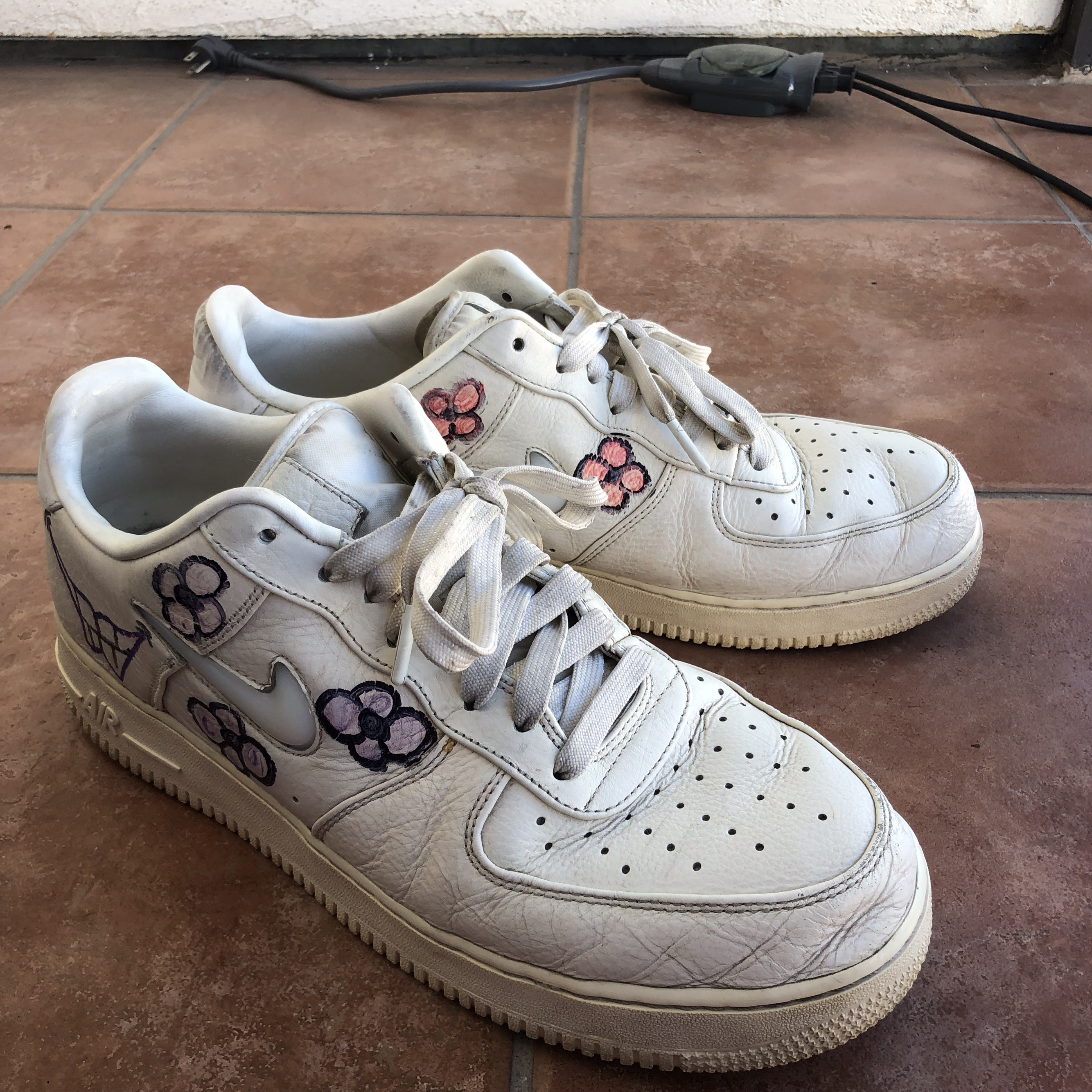 white Nike Air Force 1 with hand drawn