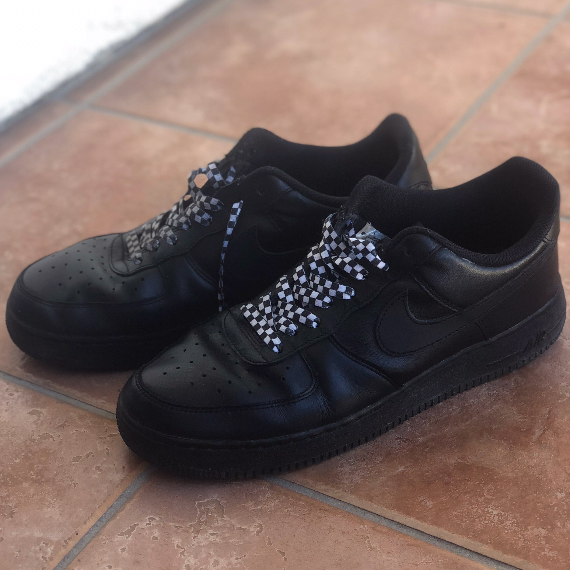 Black nike Air Force 1 Ones, with