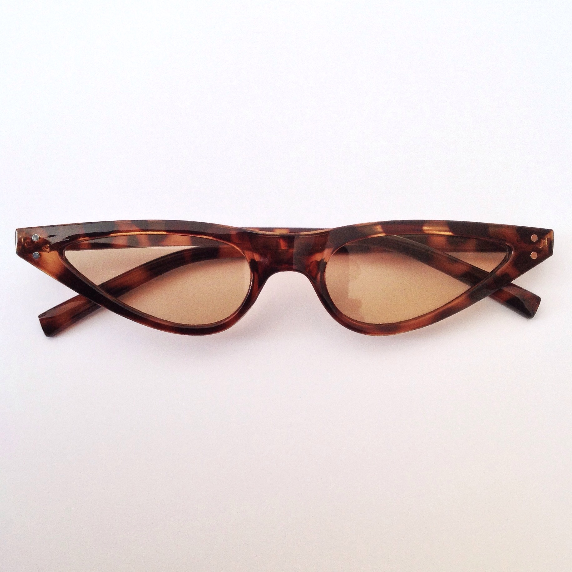 34b56e78c7  neonalien. last year. United Kingdom. On trend Retro style thin small  Tortoise shell Cat Eye Sunglasses ...