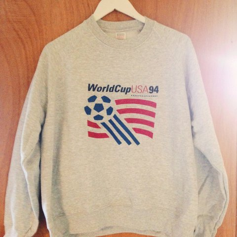 201e0c723  everydaypeople. 3 years ago. United Kingdom. Vintage World Cup USA 94  sweatshirt.