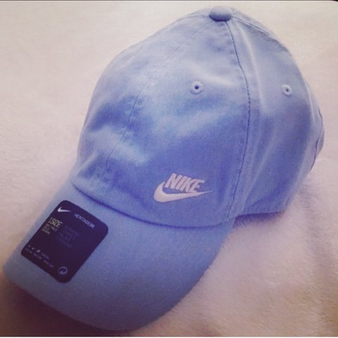 22f9309948cb2 Light baby blue baseball   dad hat with a white Nike logo. a - Depop