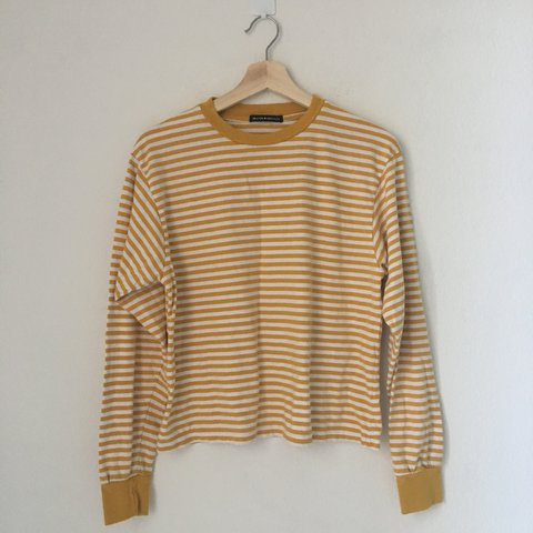 7dcbcf812b @vousvoyez. last year. United States. Brandy Melville deep yellow mustard  and white striped Acacia long sleeve top