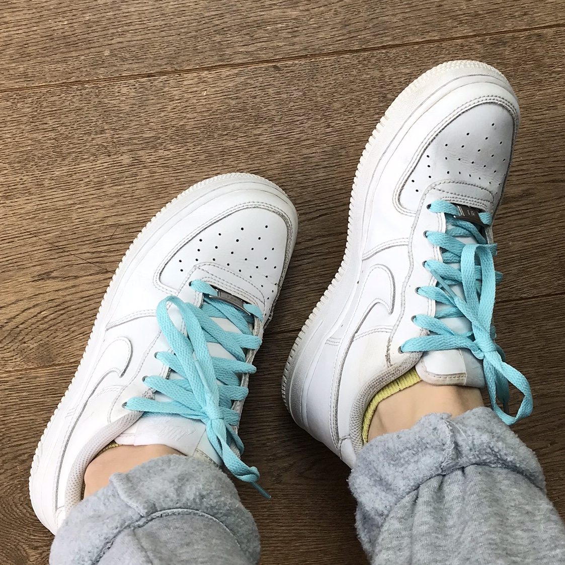 white nike Air Force 1 with mint blue