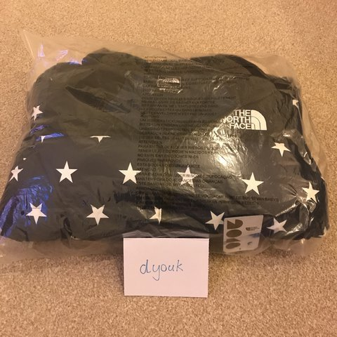0e33ab3354 The North Face IC Nuptse Jacket Blue Star Print Extremely - Depop