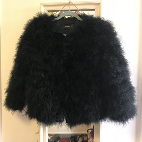 000e010d9ee @lucycousins. 10 months ago. York, United Kingdom. Real ostrich feather  jacket. Black Fluffy