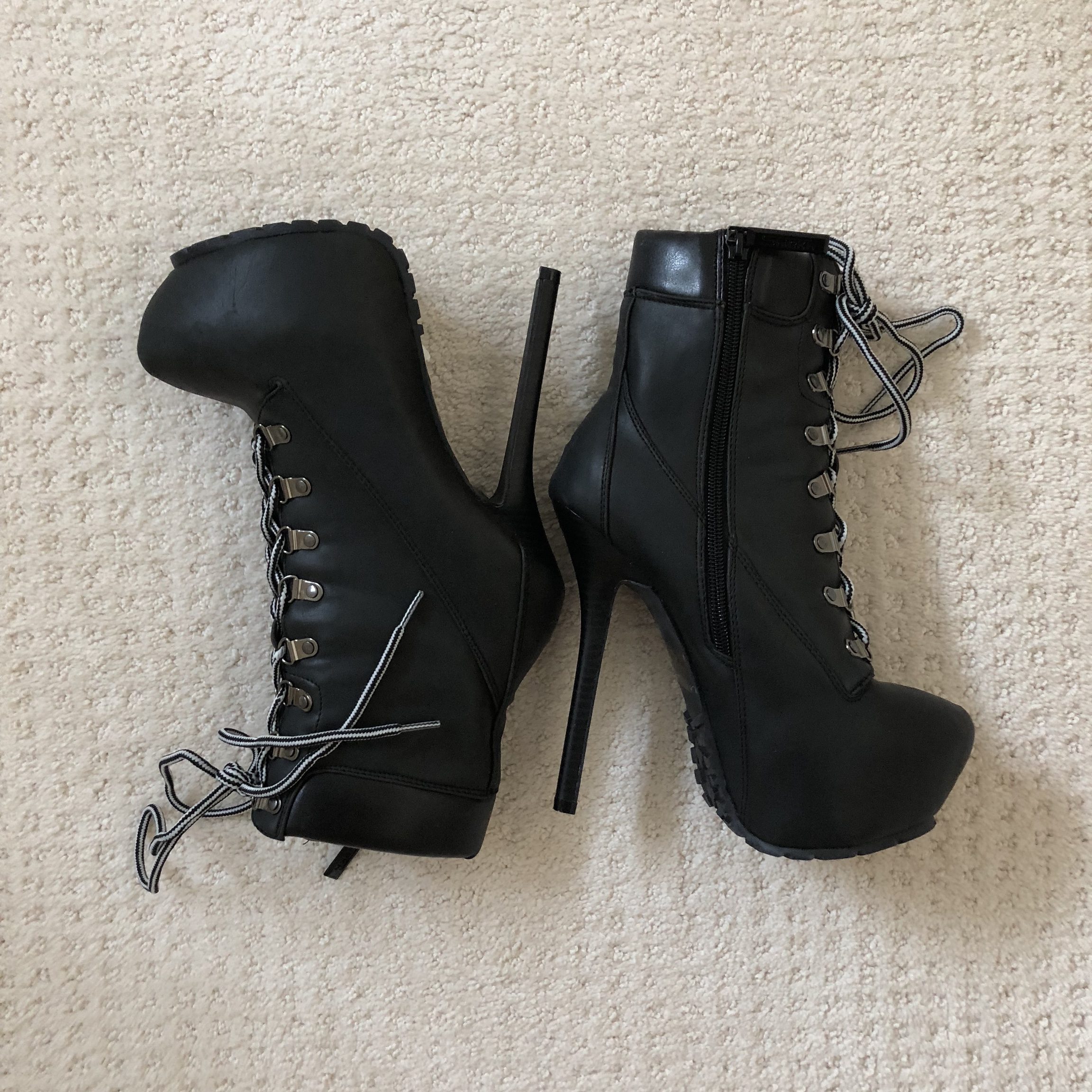 Some black faux leather combat boot heels! Anyone Depop