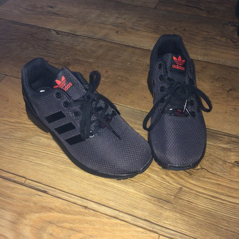 c1ad06fb731a6 SOLD ON EBAY Adidas black and red ZX Flux torsion trainers - Depop