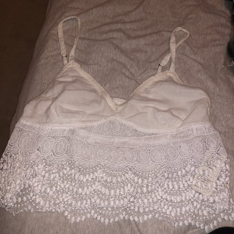aa22819cd8e Hollister white flows crop top with lace detail. Straps are - Depop