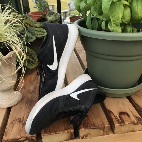 150a0d6e773a nike women s size 10 running shoes for sale. The black shoes - Depop