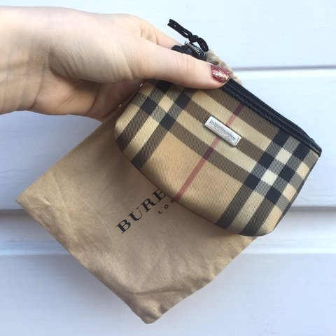 210238e225 @backinthedayvintage. 5 months ago. Sheffield, United Kingdom. Womens Burberry  purse in iconic nova check ...