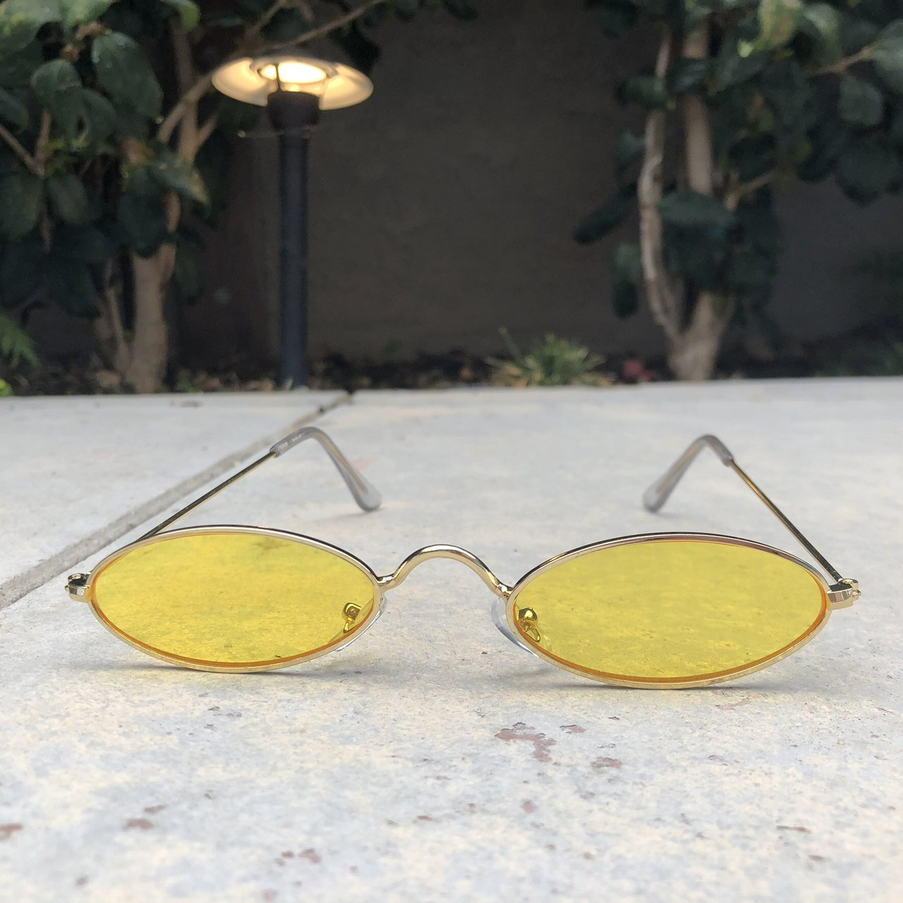 bb9e9dba099 slim oval small sunglasses. Yellow tinted lenses with gold - Depop