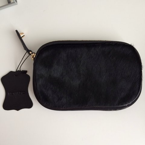 15dbd6931d24 Nomadic clutch with pony fur style finish to one side. Never - Depop