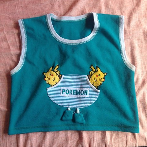 4aa5311611eb8a THE CUTEST VINTAGE 90s POKEMON CROP TOP! Has a lil pocket at - Depop