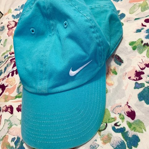 4bbba972ce506 Teal Nike hat Price reflects the foundation stain on the - Depop