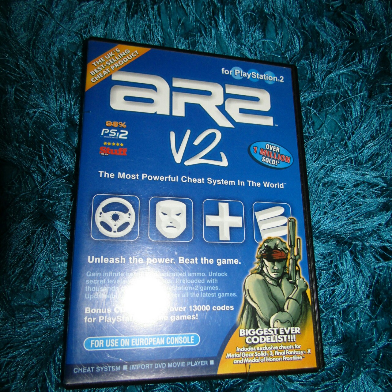 PlayStation 2 Games, ar2 v2 cheat system and TY the    - Depop