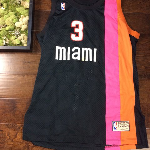 11d8c29bace0 Mitchell   Ness Dwayne Wade throw back Miami Heat jersey in - Depop