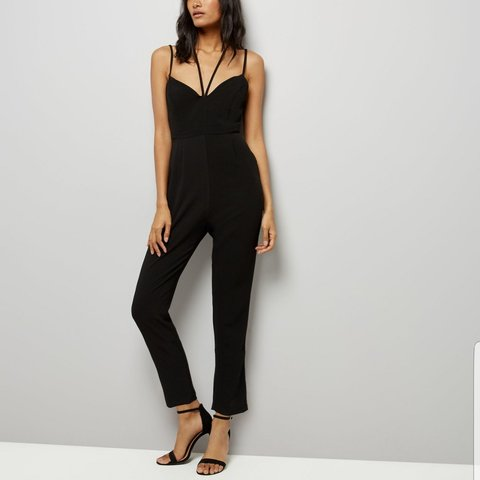 864ba6d25013 Black strappy jumpsuit with tapered leg. Size 8 but would a - Depop