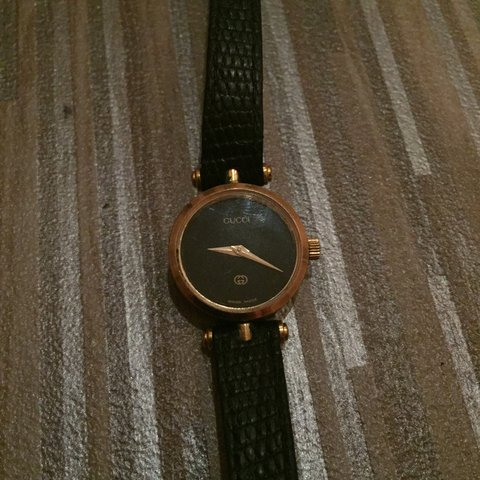 9496a593a78  kane rush1. 6 months ago. United Kingdom. Vintage 90 s Gucci watch. Black  and gold. Women s 20 cm length