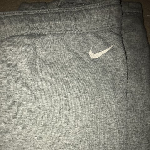 5496b17c579e nike trackie jogging bottoms in grey size large waist is - Depop