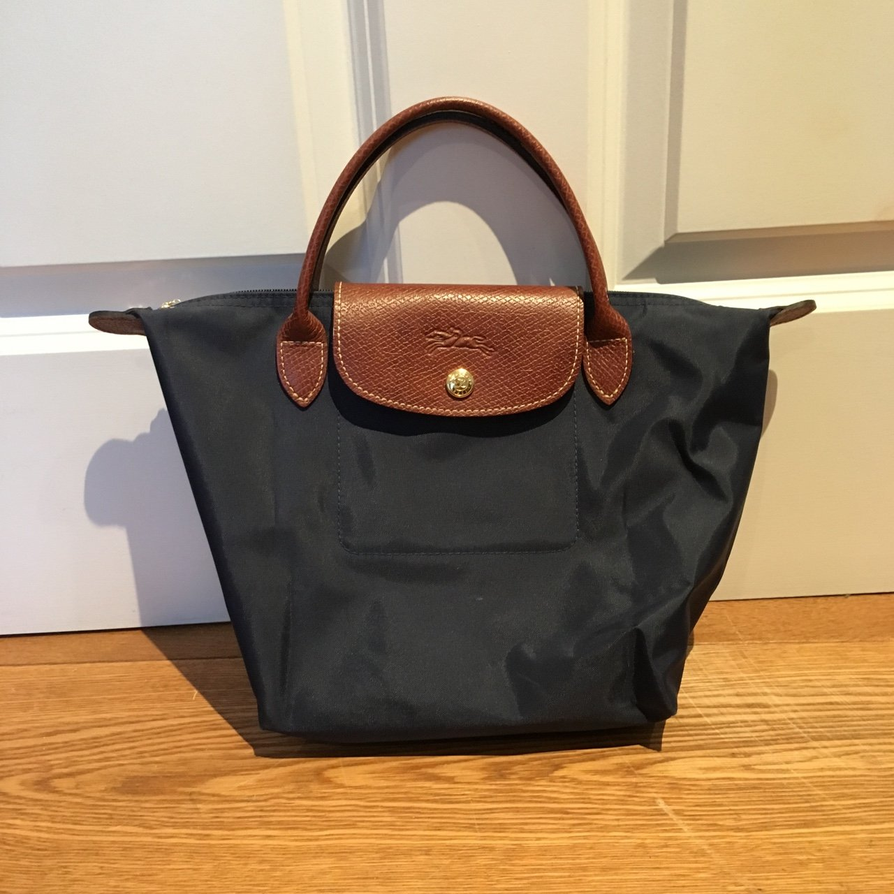 3e62f1c9e002 Longchamp Le pliage small navy blue nylon handbag. Zip at or - Depop