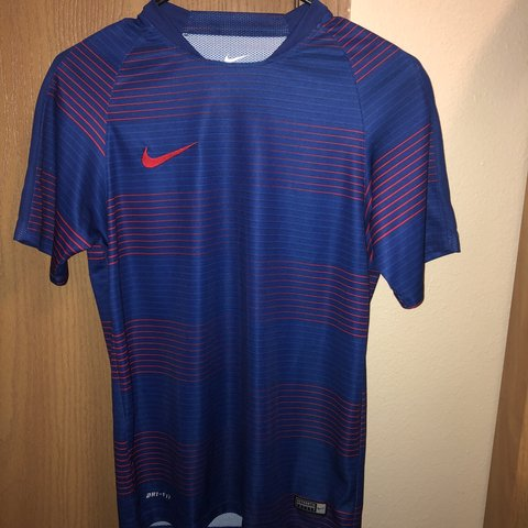 44846ee47 Red and Blue Nike Soccer Jersey Men s Small It has a small - Depop