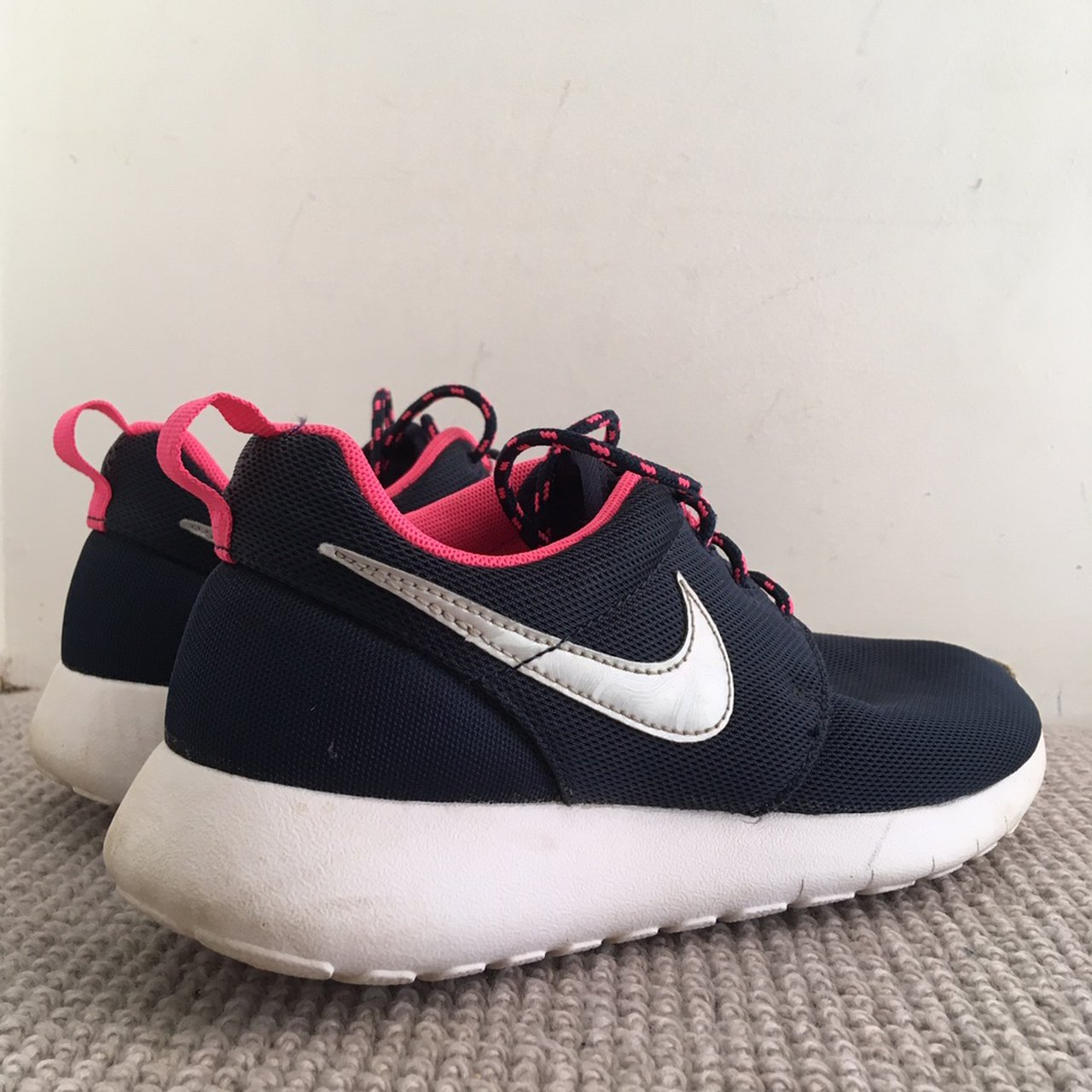 Nike navy blue and pink trainers with a