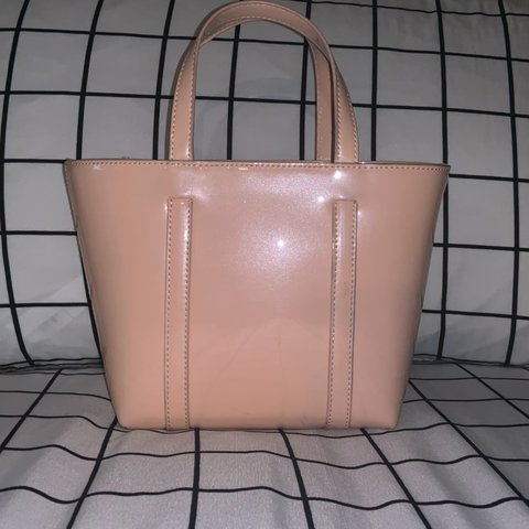 46bcd5af44 @jeninmorales. 8 days ago. Palmhurst, United States. Super cute light pink  vinyl purse ...