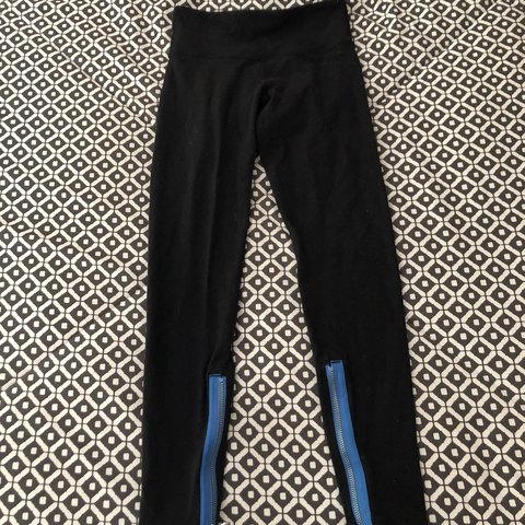 1bec2cd24 black lulu lemon yoga pants. blue zipper at the bottom. worn - Depop