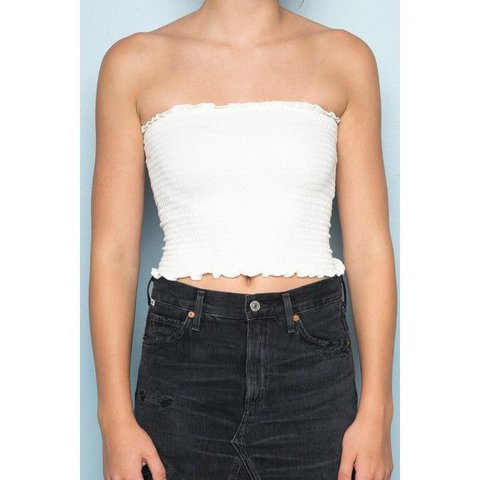 5bb22e803d4 Brandy Melville stretchy White ruched strapless boob tube • - Depop