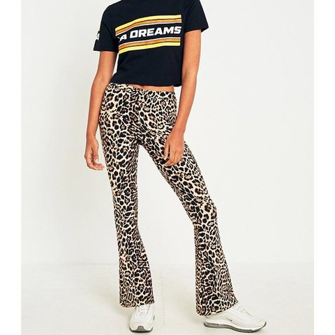 d95a07df44660e Selling urban outfitter leopard flared leggings in size s is - Depop